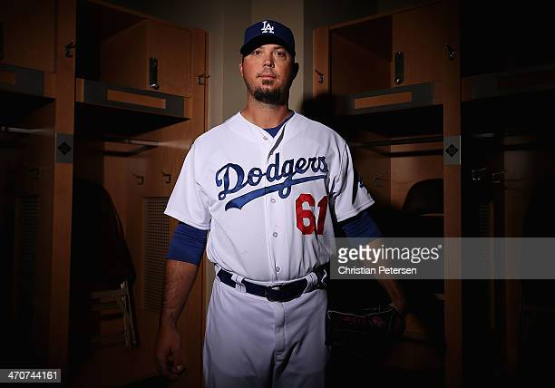 Pitcher Josh Beckett of the Los Angeles Dodgers poses for a portrait during spring training photo day at Camelback Ranch on February 20, 2014 in...