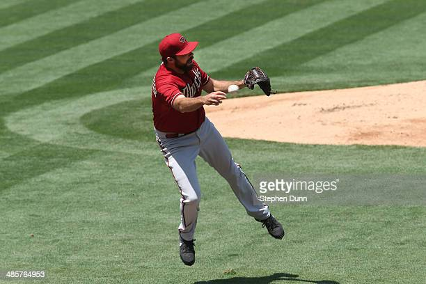 Pitcher Josh Collmenter of the Arizona Diamondbacks throws to first for the out after fielding a ground ball hit by Dee Gordon of the Los Angeles...
