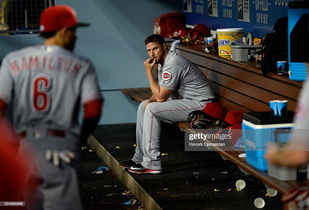 Pitcher Josh Smith #73 of the Cincinnati Reds reacts in the dugout after the Los Angeles Dodgers defeated the Reds, 8-2, at Dodger Stadium May 24, 2016, in Los Angeles, California.