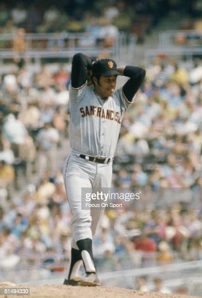 Pitcher Juan Marichal of the San Francisco Giants goes into his windup against the Philadelphia Phillies at Veterans Stadium during the early 1970s...