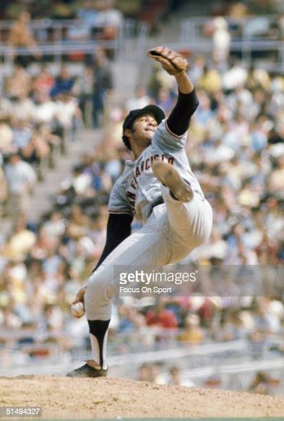 Pitcher Juan Marichal of the San Francisco Giants pitches against the Philadelphia Phillies at Veterans Stadium during the early 1970s in...