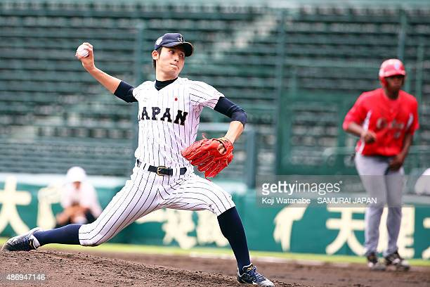 Pitcher Jumpei Takahashi of Japan pitches in the top half of the third inning in the super round game between Japan v Cuba during the 2015 WBSC U-18...