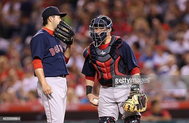 Pitcher Junichi Tazawa and catcher Christian Vazquez of the Boston Red Sox confer in the eighth inning against the Los Angeles Angels of Anaheim at...
