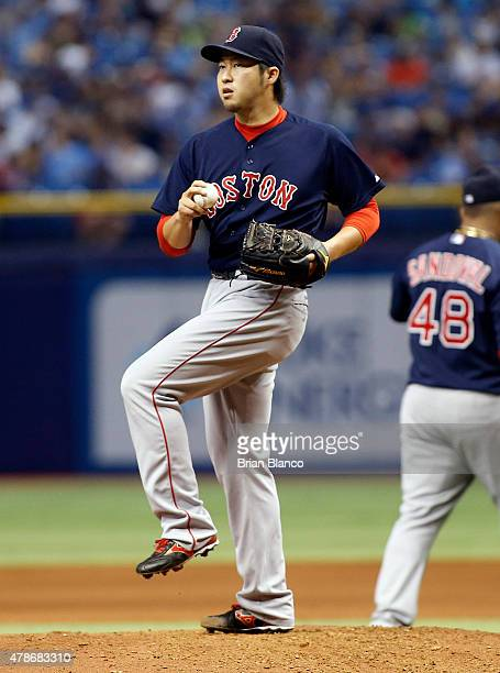 Pitcher Junichi Tazawa of the Boston Red Sox warms up on the mound before pitching during the seventh inning of a game against the Tampa Bay Rays on...