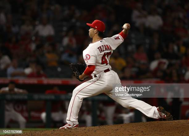 Pitcher Junichi Tazawa of the Los Angeles Angels of Anaheim pitches during the eighth inning of the MLB game against the Oakland Athletics at Angel...