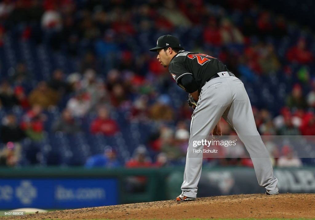 Pitcher Junichi Tazawa #25 of the Miami Marlins gets set to deliver a pitch against the Philadelphia Phillies during seventh inning of a game at Citizens Bank Park on April 7, 2018 in Philadelphia, Pennsylvania.
