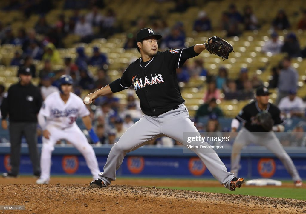 Pitcher Junichi Tazawa #25 of the Miami Marlins pitches in relief in the eighth inning during the MLB game against the Los Angeles Dodgers at Dodger Stadium on April 25, 2018 in Los Angeles, California. The Marlins defeated the Dodgers 8-6.