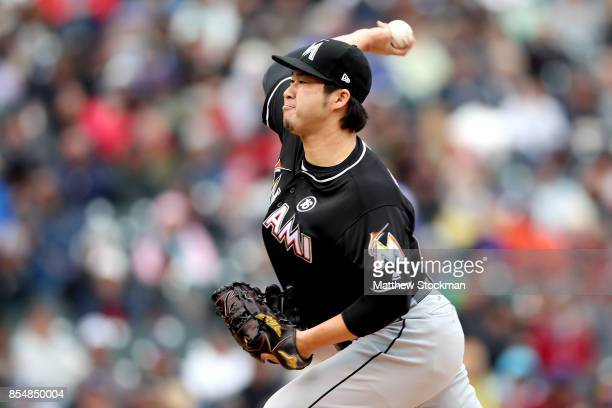 Pitcher Junichi Tazawa of the Miami Marlins throws in the fourth inning against the Colorado Rockies at Coors Field on September 27 2017 in Denver...