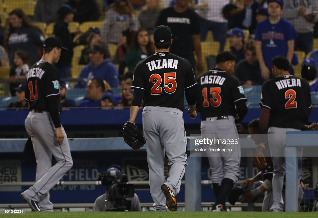 Pitcher Junichi Tazawa #25 of the Miami Marlins walks back to the dugout after striking out Chase Utley #26 of the Los Angeles Dodgers (not in photo) for the third out of the eighth inning during the MLB game at Dodger Stadium on April 25, 2018 in Los Angeles, California. The Marlins defeated the Dodgers 8-6.