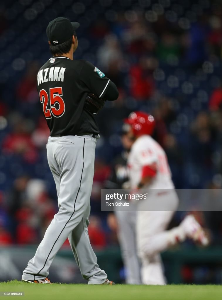 Pitcher Junichi Tazawa #25 of the Miami Marlins watches as Jorge Alfaro #38 of the Philadelphia Phillies rounds the bases after hitting a home run during seventh inning of a game at Citizens Bank Park on April 7, 2018 in Philadelphia, Pennsylvania.