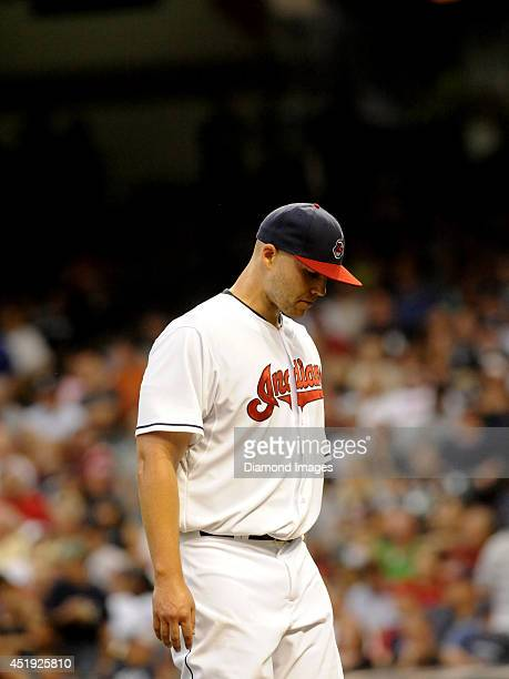 Pitcher Justin Masterson of the Cleveland Indians walks off the field after two and one third innings pitched of a game against the New York Yankees...