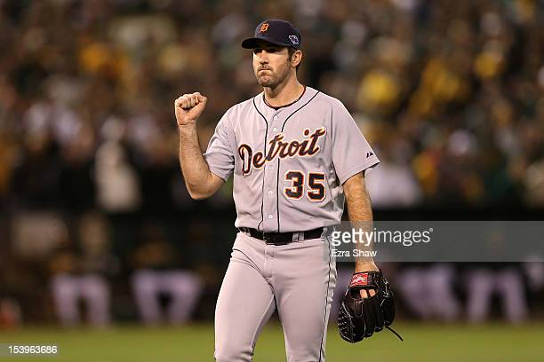 Pitcher Justin Verlander of the Detroit Tigers reacts after Coco Crisp of the Oakland Athletics to ground out to end the eighth inning in Game Five...
