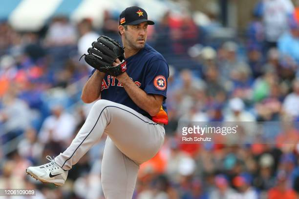 Pitcher Justin Verlander of the Houston Astros delivers a pitch against the New York Mets during the first inning of a spring training baseball game...
