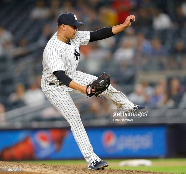 Pitcher Justus Sheffield of the New York Yankees follows through as he pitches in relief for his Major League debut in an MLB baseball game against...