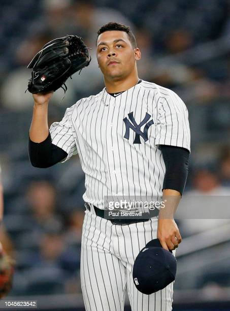 Pitcher Justus Sheffield of the New York Yankees reacts as he pitches in relief for his Major League debut in an MLB baseball game against the Boston...