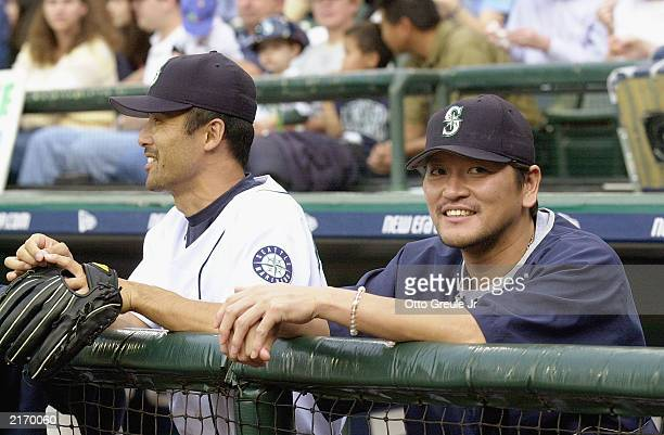 Pitcher Kazuhiro Sasaki of the Seattle Mariners and his teammate pitcher Shigetoshi Hasegawa watch the MLB game against the Baltimore Orioles at...