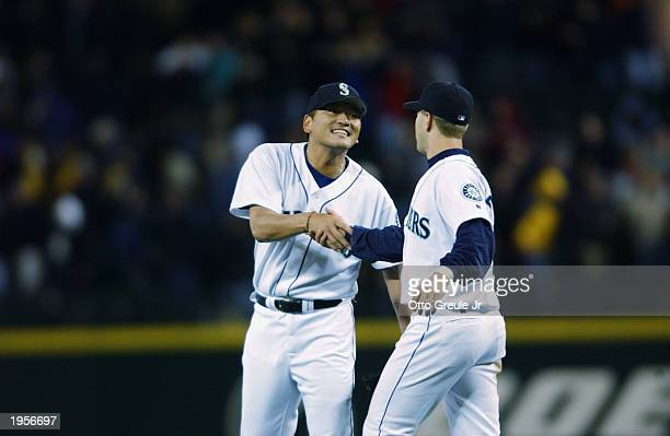 Pitcher Kazuhiro Sasaki of the Seattle Mariners shakes hands with Willie Bloomquist after beating the Oakland Athletics at Safeco Field on April 14...