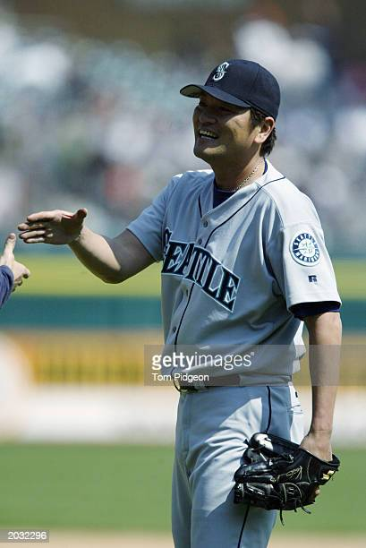 Pitcher Kazuhiro Sasaki of the Seattle Mariners smiles after closing out the ninth inning against the Detroit Tigers at Comerica Park in Detroit...