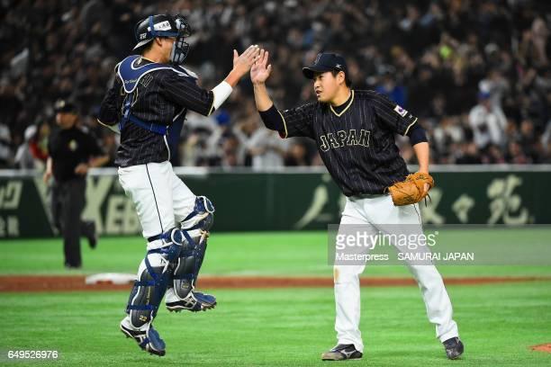 Pitcher Kazuhisa Makita and Catcher Seiji Kobayashi celebrate their 41 win in the World Baseball Classic Pool B Game Three between Japan and...