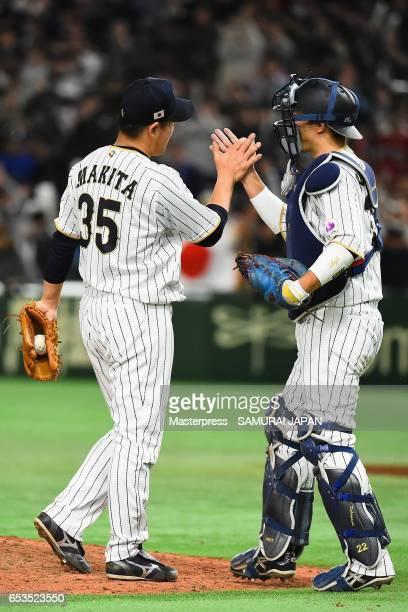 Pitcher Kazuhisa Makita and Catcher Seiji Kobayashi of Japan celebrate after their win in the World Baseball Classic Pool E Game Six between Israel...