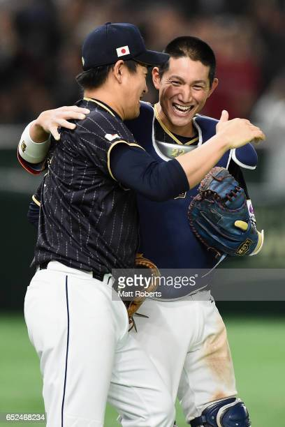 Pitcher Kazuhisa Makita and Catcher Seiji Kobayashi of Japan celebrate their 86 victory after the World Baseball Classic Pool E Game Two between...