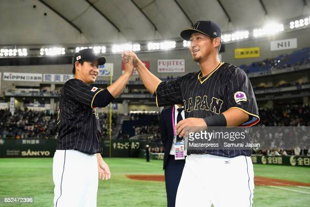 Pitcher Kazuhisa Makita and Infielder Sho Nakata of Japan celebrate their victory after the World Baseball Classic Pool E Game Two between Japan and...
