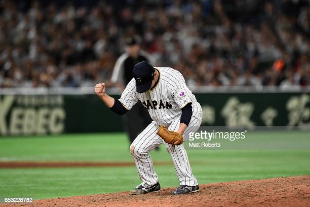 Pitcher Kazuhisa Makita of Japan celebrates his team's 58 victory after the World Baseball Classic Pool E Game Four between Cuba and Japan at the...
