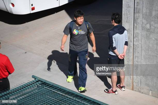Pitcher Kazuhisa Makita of Japan is seen on arrival at the stadium prior to the exhibition game between Japan and Chicago Cubs at Sloan Park on March...