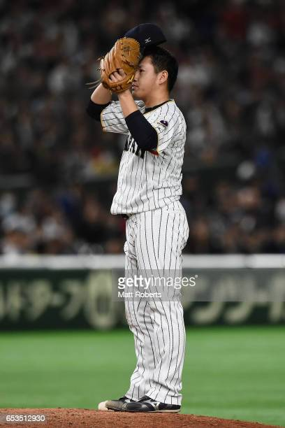 Pitcher Kazuhisa Makita of Japan reacts in the top of the ninth inning during the World Baseball Classic Pool E Game Six between Israel and Japan at...
