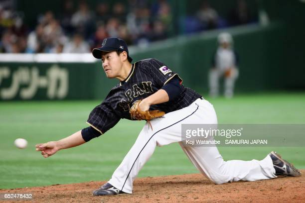 Pitcher Kazuhisa Makita of Japan throws in the bottom of eleventh inning during the World Baseball Classic Pool E Game Two between Japan and...