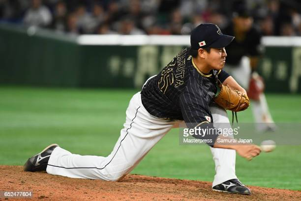 Pitcher Kazuhisa Makita of Japan throws in the bottom of tenth inning during the World Baseball Classic Pool E Game Two between Japan and Netherlands...