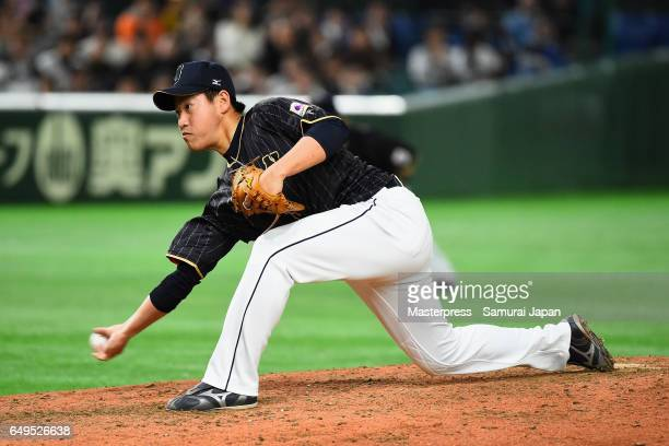 Pitcher Kazuhisa Makita of Japan throws in the bottom of the ninth inning during the World Baseball Classic Pool B Game Three between Japan and...