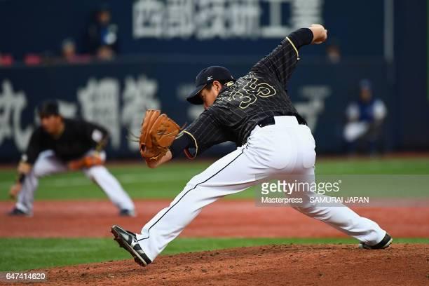 Pitcher Kazuhisa Makita of Japan throws in the bottom of the third inning during the World Baseball Classic WarmUp Game between Japan and Hanshin...
