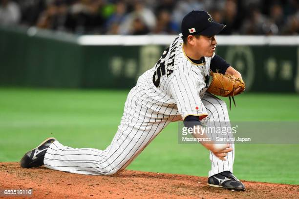 Pitcher Kazuhisa Makita of Japan throws in the top of the ninth inning during the World Baseball Classic Pool E Game Six between Israel and Japan at...