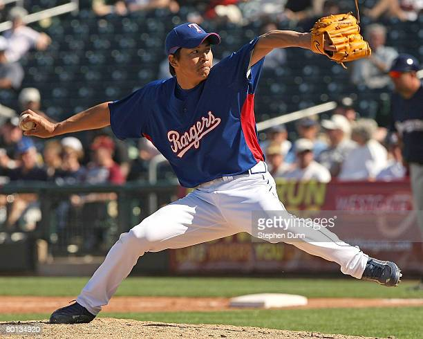 Pitcher Kazuo Fukumori of the Texas Rangers throws a pitch against the Milwaukee Brewers on March 5 2008 at Surprise Stadium in Surprise Arizona