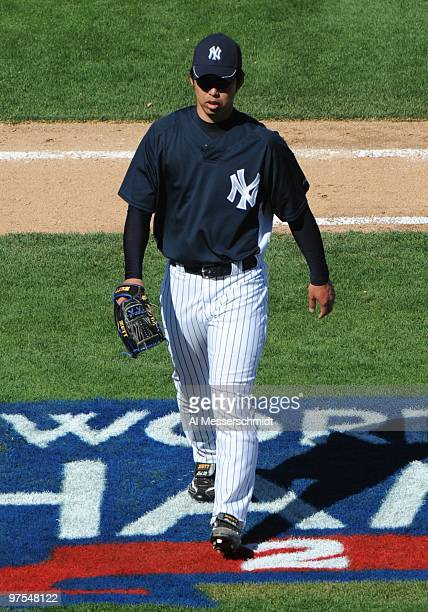Pitcher Kei Igawa of the New York Yankees walks to the dugout against the Tampa Bay Rays March 5 2010 at the George M Steinbrenner Field in Tampa...
