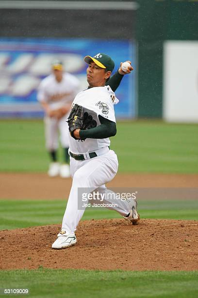 Pitcher Keiichi Yabu of the Oakland Athletics delivers a pitch against the New York Mets during the MLB game at McAfee Coliseum on June 16 2005 in...