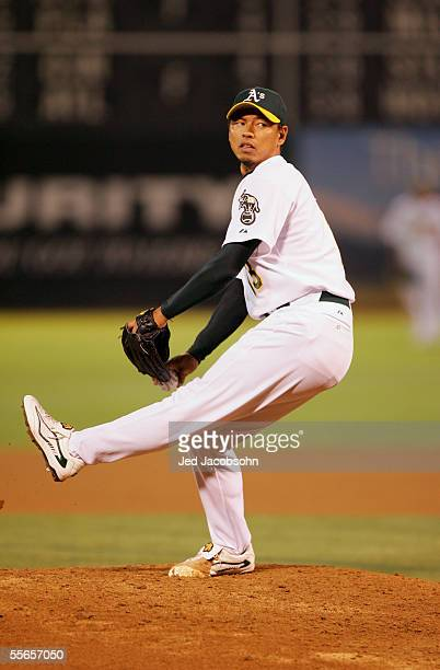 Pitcher Keiichi Yabu of the Oakland Athletics delivers a pitch against the New York Yankees during a MLB game at McAfee Coliseum on September 2 2005...
