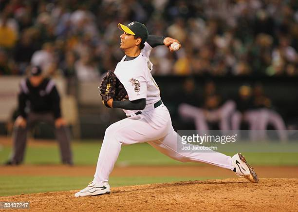 Pitcher Keiichi Yabu of the Oakland Athletics throws against the Los Angeles Angels of Anaheim during an MLB game at McAfee Coliseum on August 9 2005...