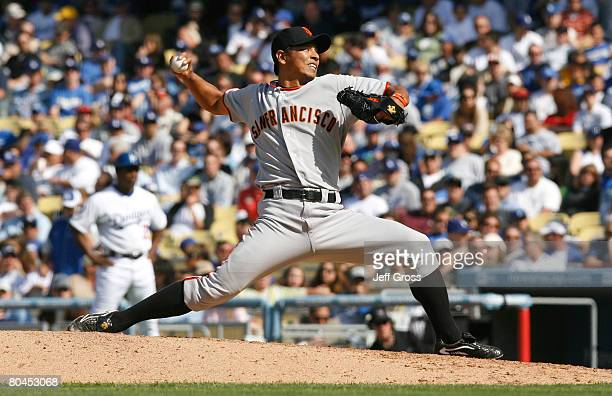 Pitcher Keiichi Yabu of the San Francisco Giants delivers a piitch during the Opening Day game against the Los Angeles Dodgers at Dodger Stadium on...
