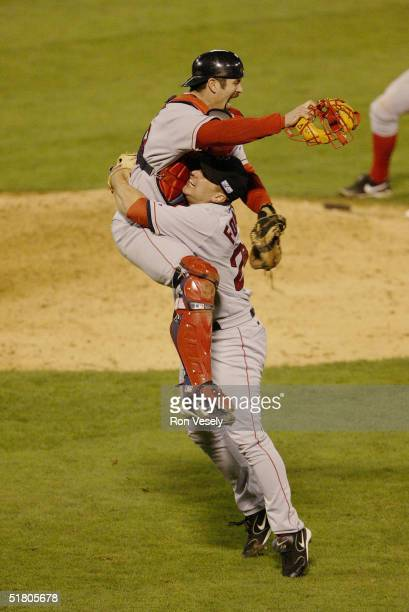 Pitcher Keith Foulke and catcher Jason Varitek of the Boston Red Sox celebrate after winning game four of the 2004 World Series against the St Louis...