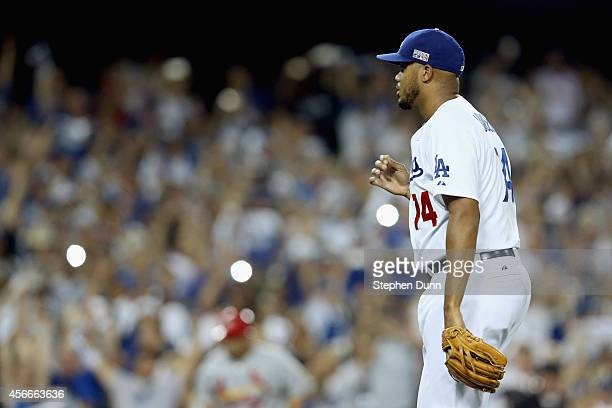 Pitcher Kenley Jansen of the Los Angeles Dodgers reacts after closing out the game to win 32 over the St Louis Cardinals in Game Two of the National...