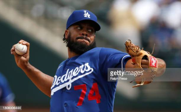 Pitcher Kenley Jansen of the Los Angeles Dodgers throws against the Texas Rangers during the fourth inning of the MLB spring training baseball game...