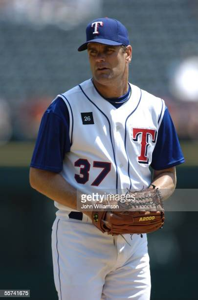 Pitcher Kenny Rogers of the Texas Rangers looks to the catcher for a sign during the game against the Minnesota Twins at Ameriquest Field in...