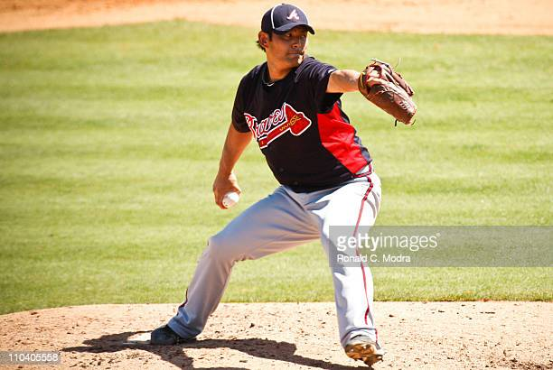 Pitcher Kenshin Kawakami of the Atlanta Braves pitches during a spring training game against the St Louis Cardinals at Donald Ross Stadium on March...