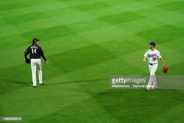 Pitcher Kenta Maeda of the Los Angeles Dodgers and Pitcher Daichi Osera of Japan warm up prior to the game four between Japan and MLB All Stars at...