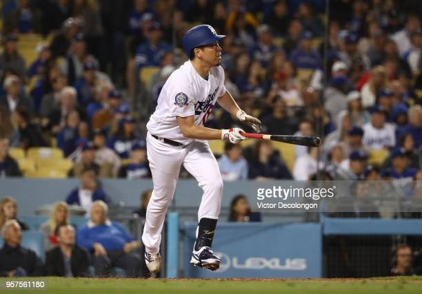 Pitcher Kenta Maeda of the Los Angeles Dodgers bats in the third inning during the MLB game against the Cincinnati Reds at Dodger Stadium on May 11...