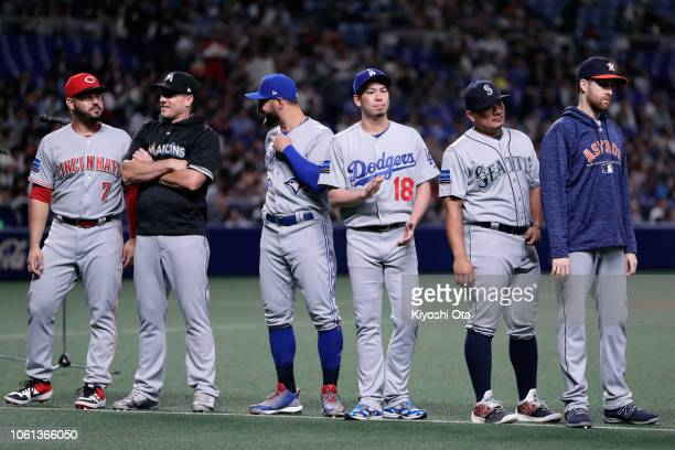 Pitcher Kenta Maeda of the Los Angeles Dodgers high and the MLB players line up prior to the game five between Japan and MLB All Stars at Nagoya Dome...