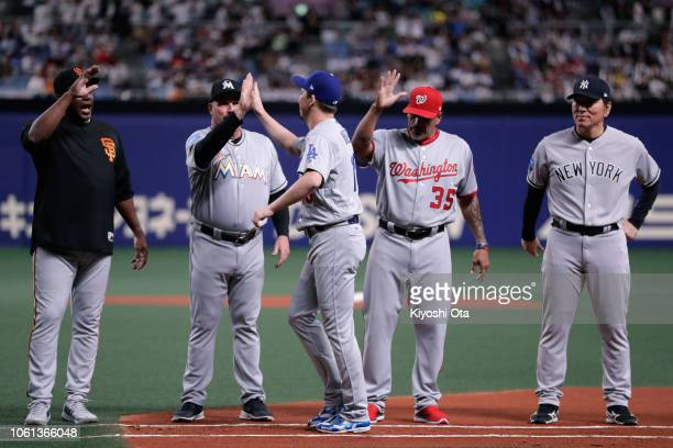 Pitcher Kenta Maeda of the Los Angeles Dodgers high fives with coaches as he is introduced prior to the game five between Japan and MLB All Stars at...