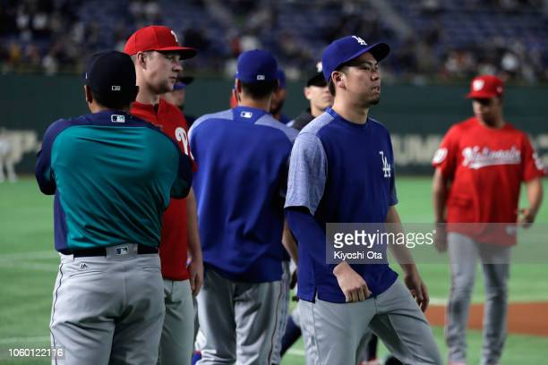 Pitcher Kenta Maeda of the Los Angeles Dodgers joins the MLB team at a warm up prior to the game three of Japan and MLB All Stars at Tokyo Dome on...